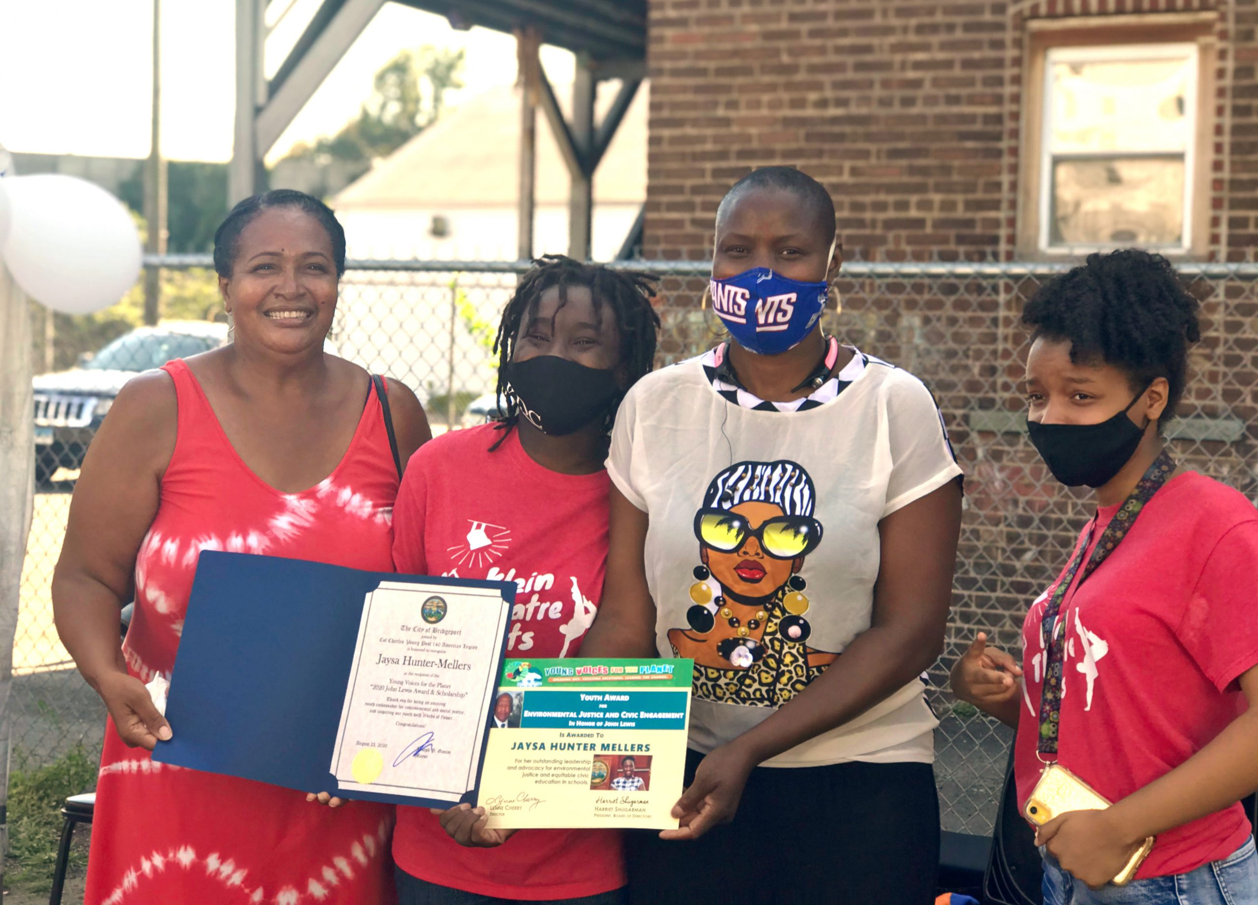 15 year old YVFP Youth Ambassador Jaysa Hunter-Mellers receives the YVFP award for Environmental Justice and Civic Engagement in Honor of Rep. John Lewis Award